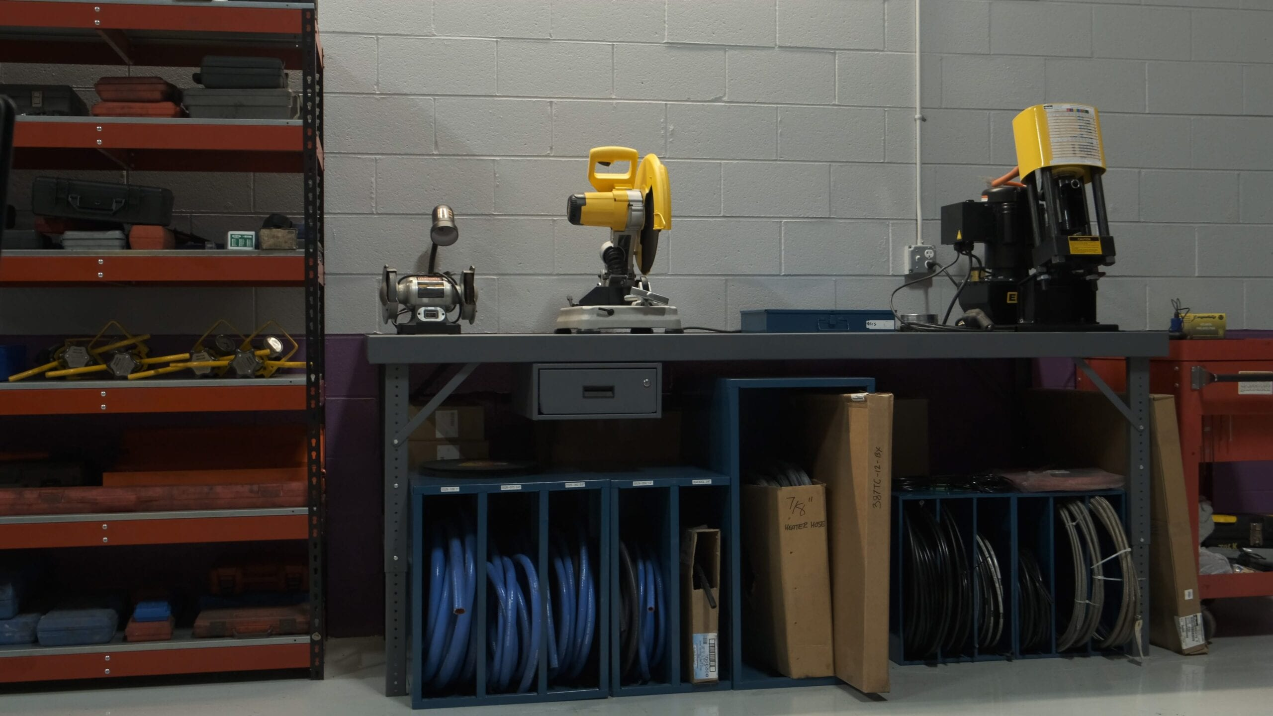 Station for custom hydraulic and air hose and fitting creation.