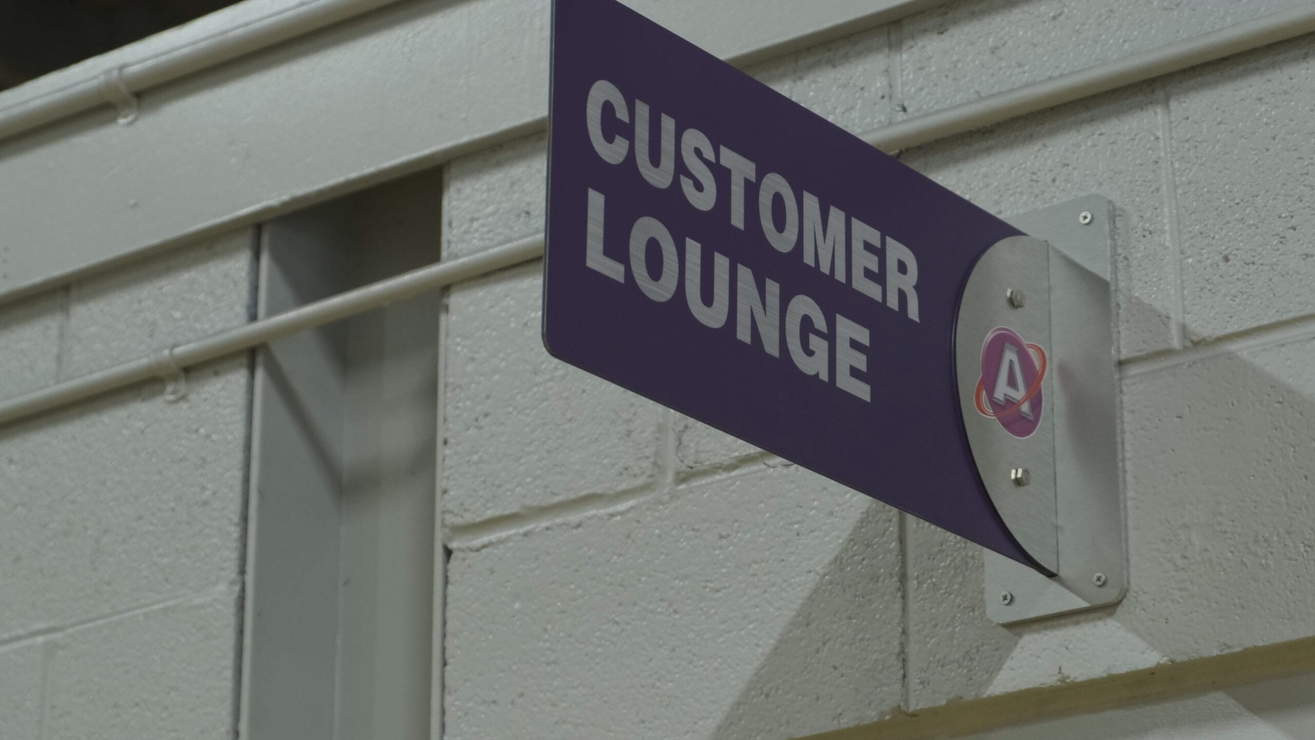 Sign outside the customer lounge.