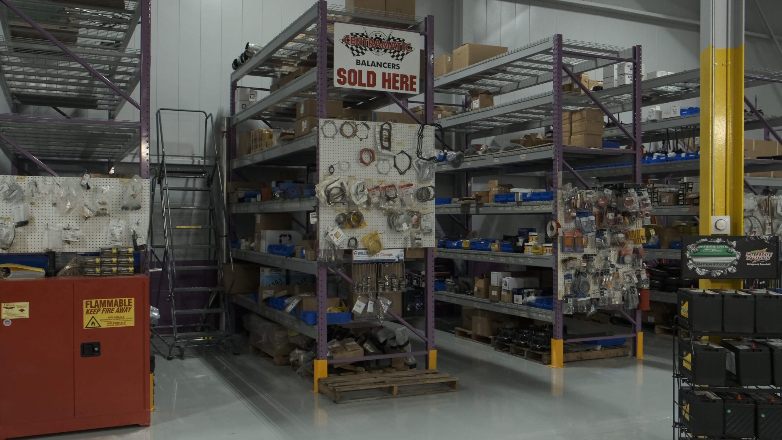 Racks of parts in the parts department of a truck repair shop.